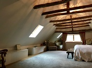 Bedroom in eaves of mill house
